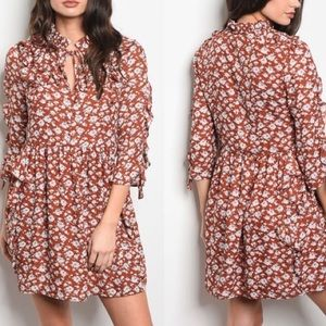 ina rust floral dress.